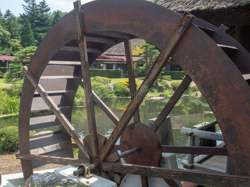 Water wheel at Oshino Hakkai village, Japan royalty free stock photo