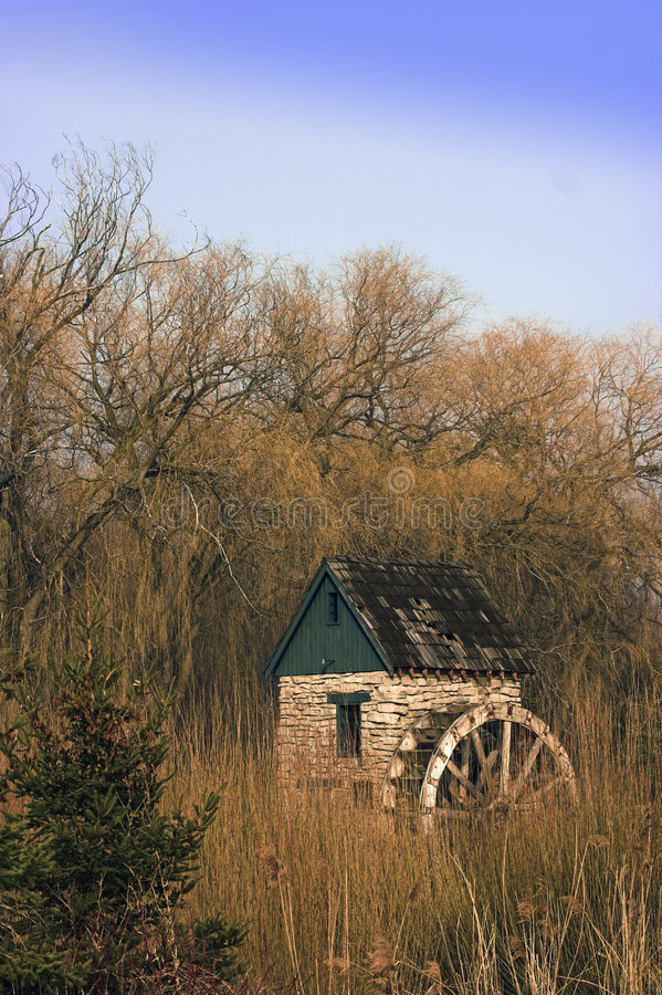 Water wheel in park. Old style water wheel in a park royalty free stock photo