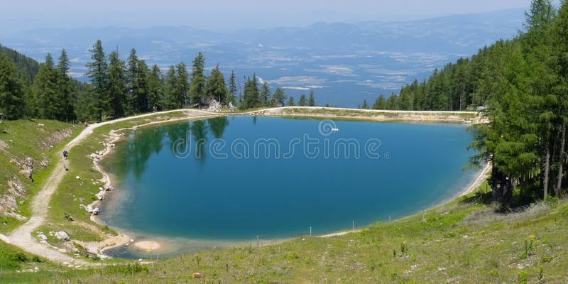 Water winter reserves lake from above with view on austrian villages. Petzen royalty free stock images