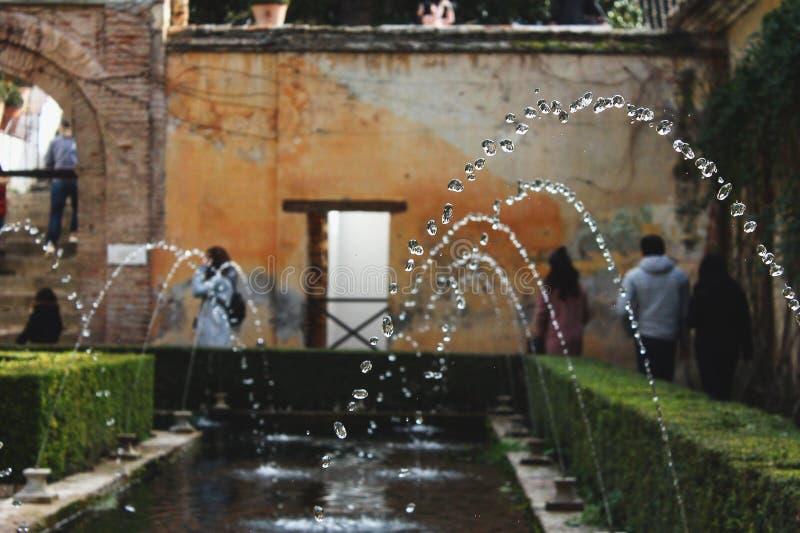 Watercaption aux jardins de Generalife image stock