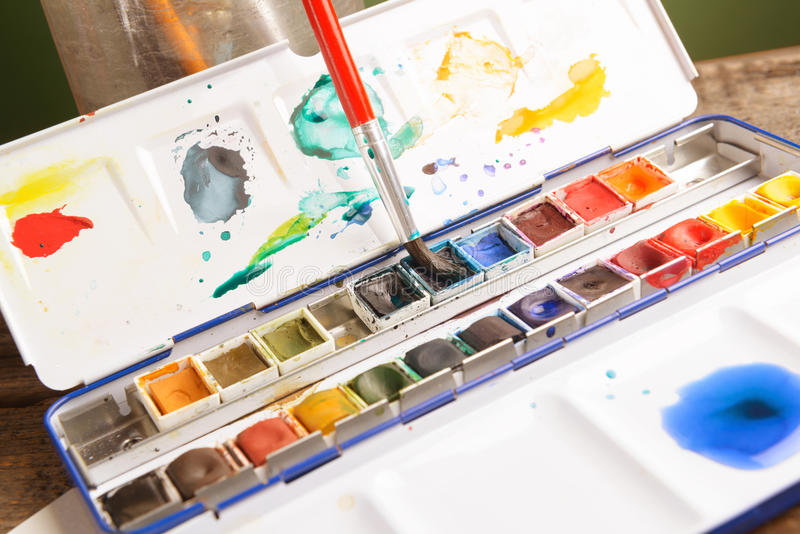 Watercolor. Professional watercolor aquarell paints in box with brush royalty free stock image