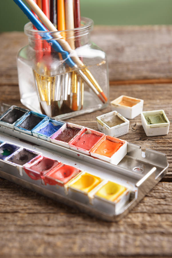 Watercolor. Professional watercolor aquarell paints in box with brushes in jar stock photo