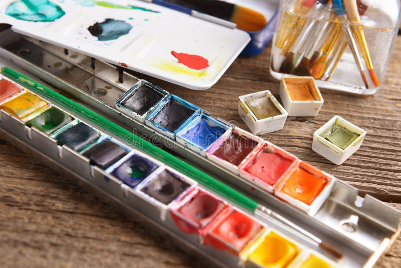 Watercolor. Professional watercolor aquarell paints in box with brushes royalty free stock photos