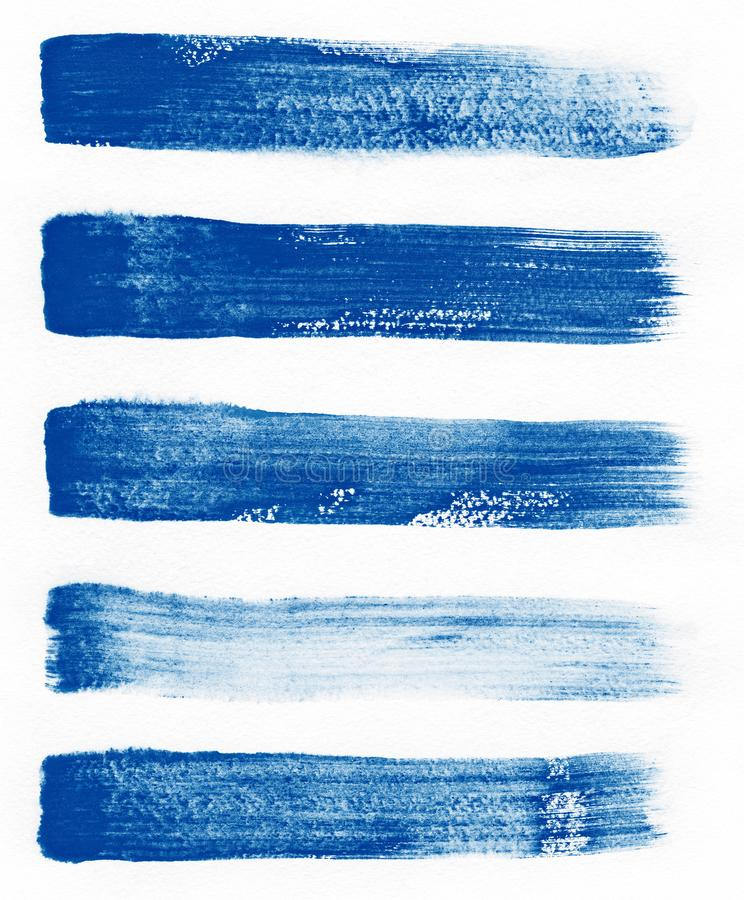 Watercolor. Blue abstract painted ink strokes set on watercolor paper. Ink strokes. Flat kind brush stroke. stock photos