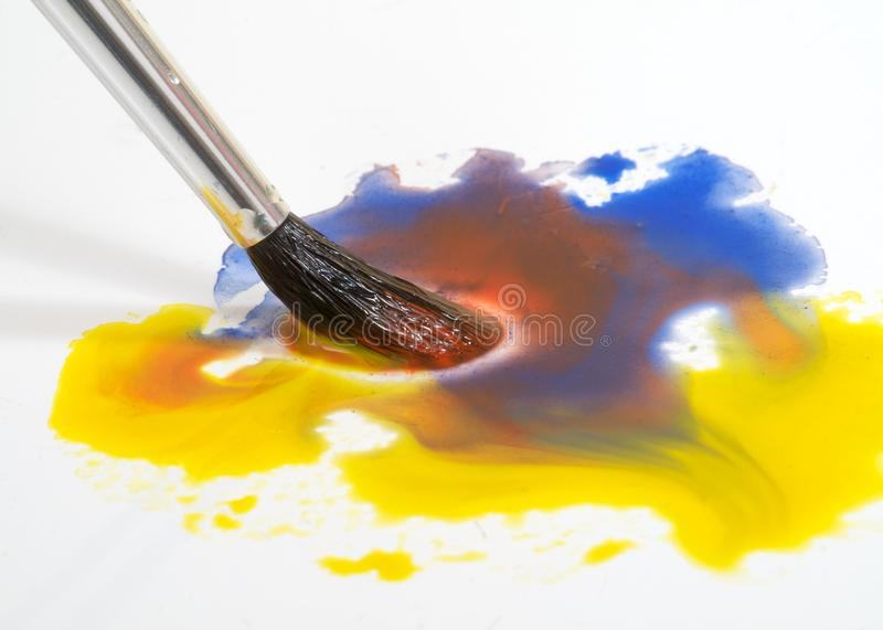 Watercolor brush and paint stock photo