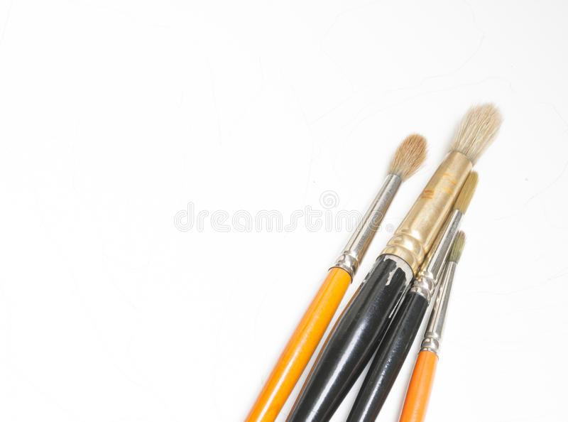 Watercolor brushes. Artist tools - used  of the fine Kolinsky type on white royalty free stock photography