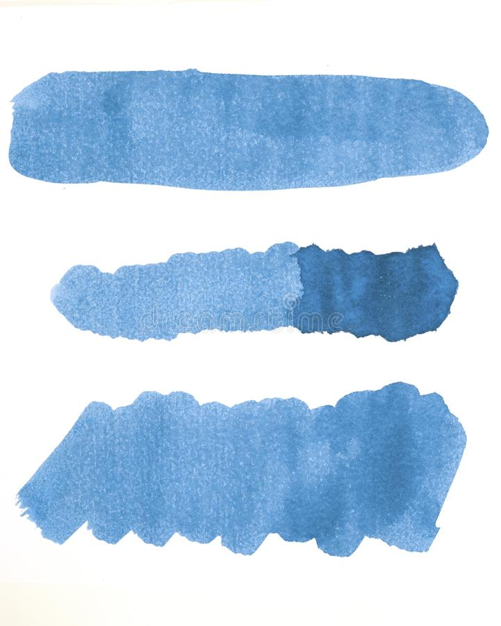 Watercolor line of blue paint on white paper stock image