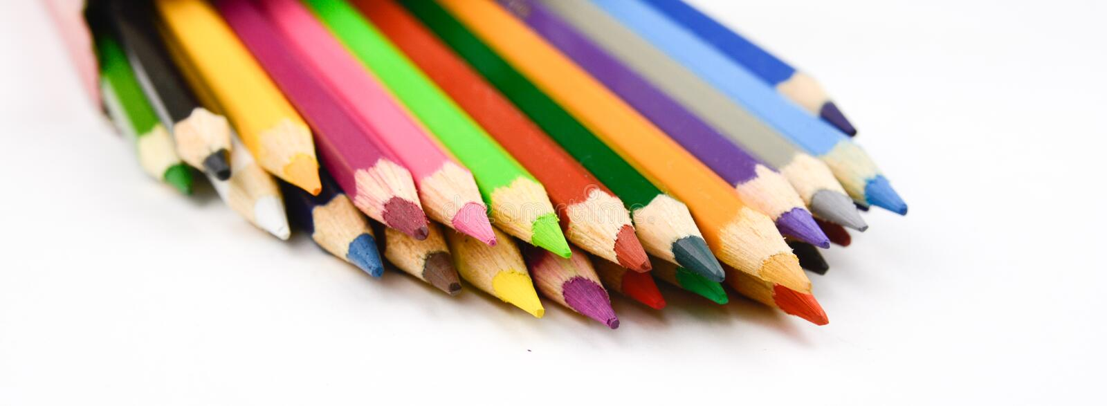 Watercolor multicolored drawing pencils on white background.  royalty free stock photography