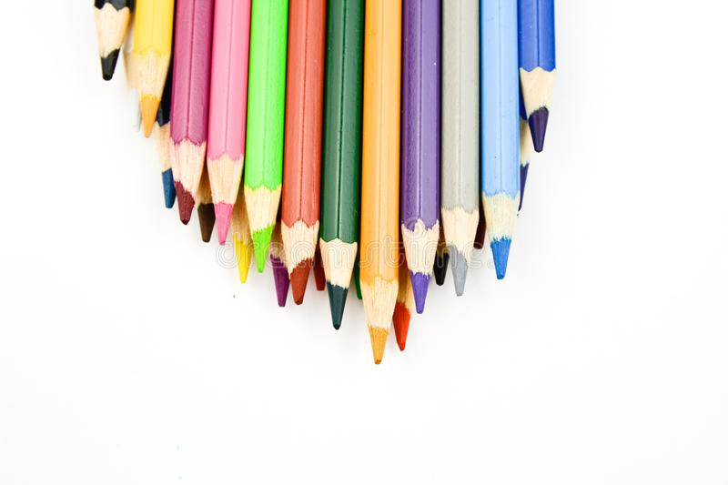 Watercolor multicolored drawing pencils on white background.  royalty free stock image