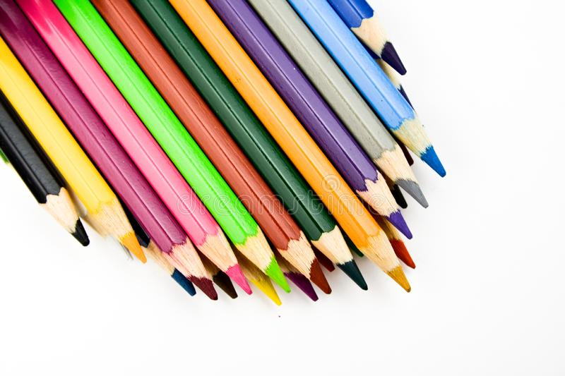 Watercolor multicolored drawing pencils on white background.  stock photos
