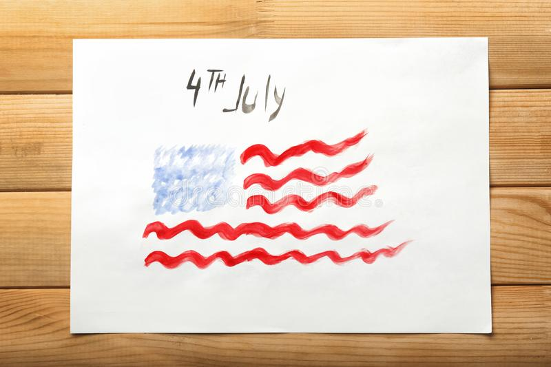 Watercolor painting of American national flag on wooden table. 4th July celebration royalty free stock photos