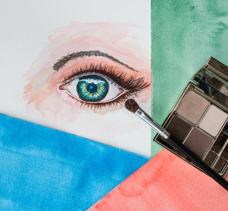 Watercolor painting of an eye, eye shadows and brush stock photography