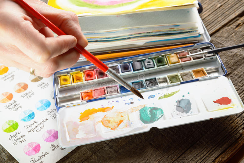 Watercolor. Professional watercolor aquarell paints in box with brush royalty free stock photo