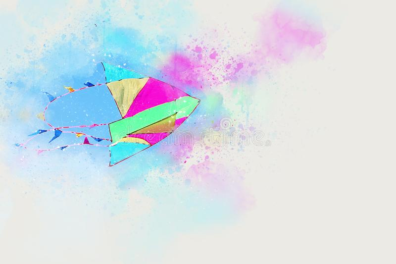 Watercolor style abstract illustration of colorful kite flying in the blue sky. Watercolor style abstract illustration of colorful kite flying in the blue sky stock photography