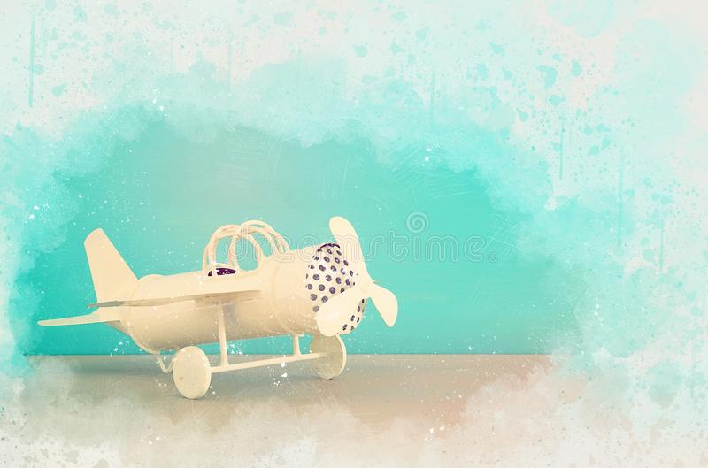 Watercolor style and abstract illustration of vintage toy plane. stock illustration