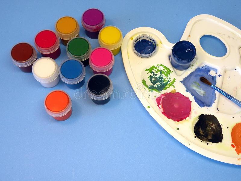 Watercolors and brush stock photo