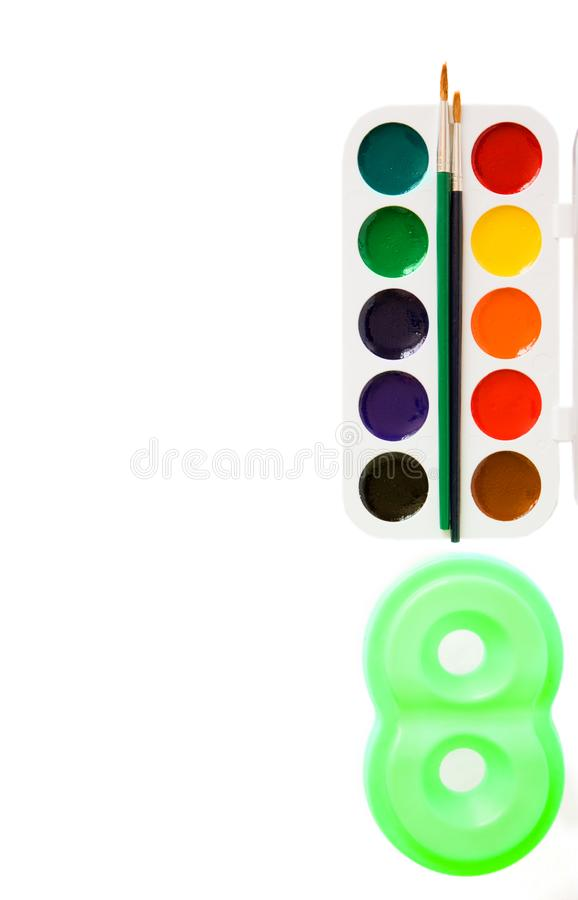 Watercolors with brushes stock photography