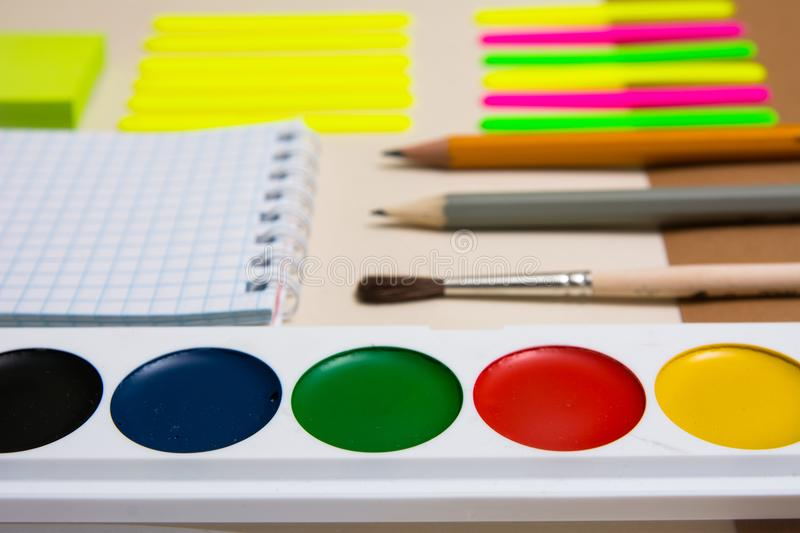 Watercolors and school supplies for primary school royalty free stock photography