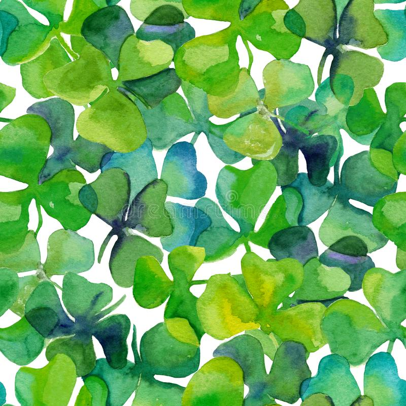 Watercolour clover leaves in full frame seamless tile royalty free stock images