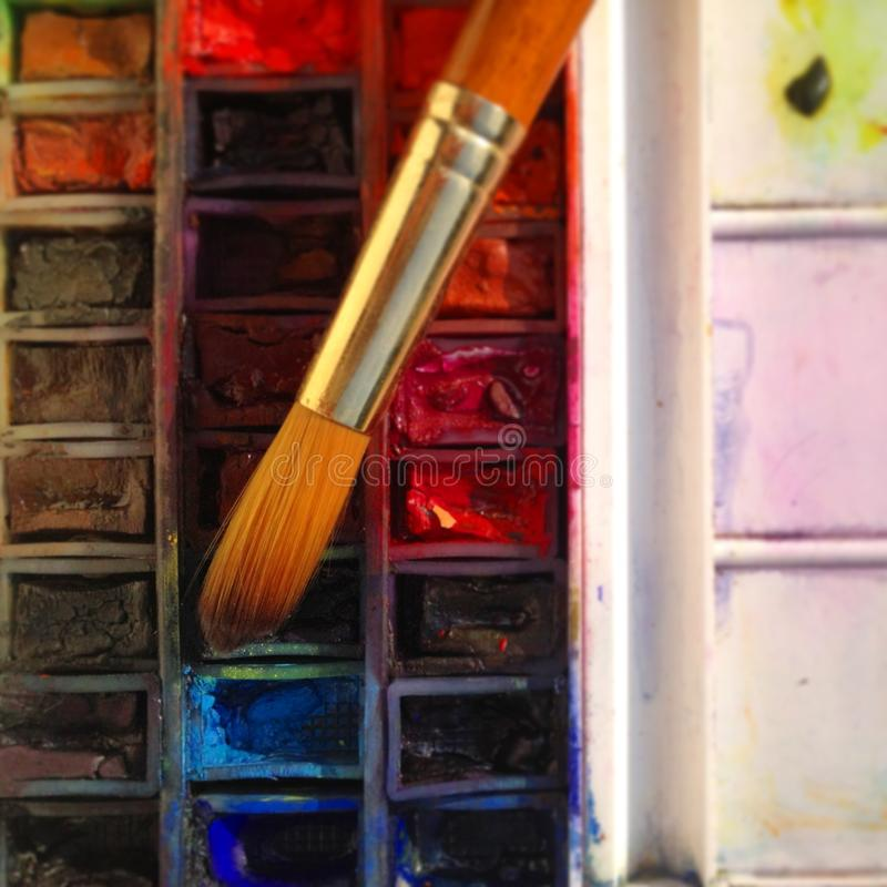Watercolour paints and brush close up royalty free stock images