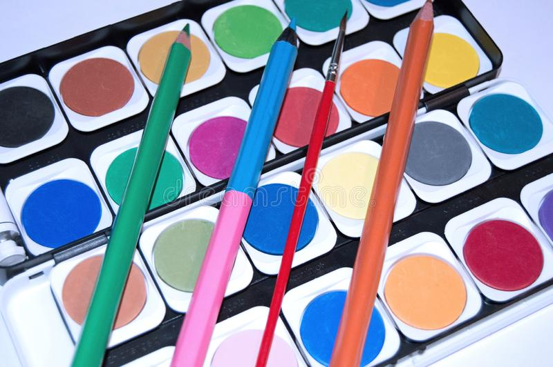 Watercolours on the table. As background.Back to school stock illustration
