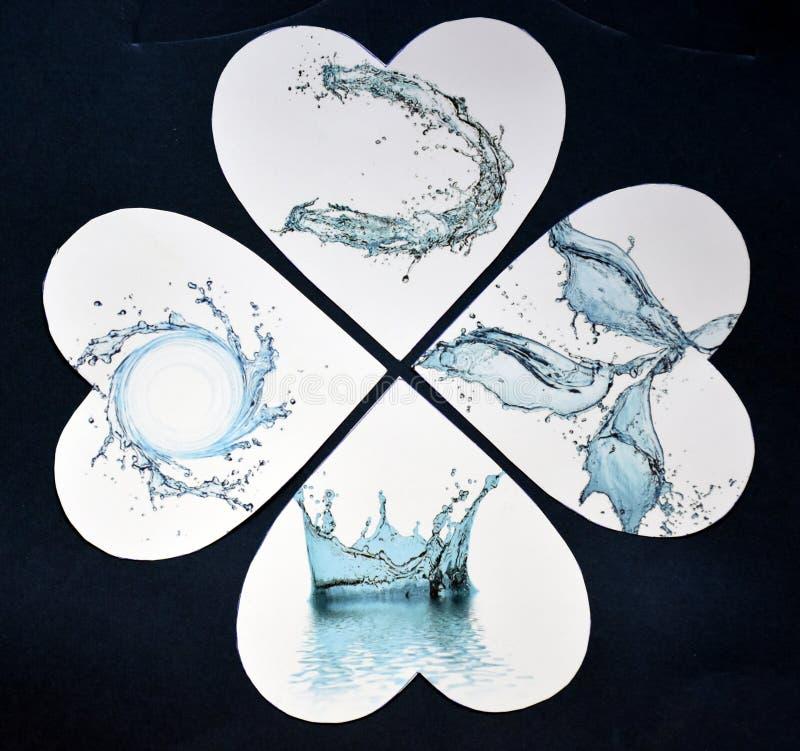 Waterdrops在心脏作为一张抽象纸拼贴画 免版税库存照片