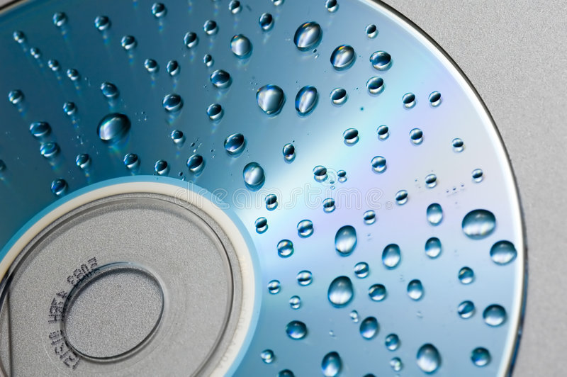 Waterdrops on cd background stock images