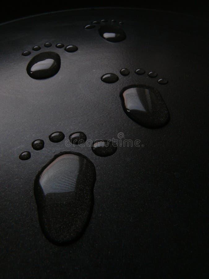 waterdrops d'empreintes de pas photos stock