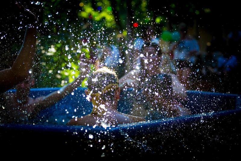 Waterdrops splashing with people in the background in a hottub stock photos