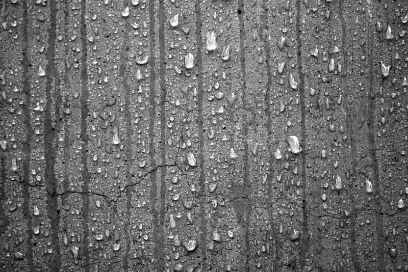 Waterdruppeltjes op Concreet, Zwart-wit stock fotografie