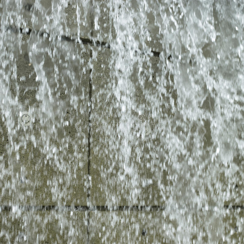Waterfall. In front of concrete royalty free stock photo