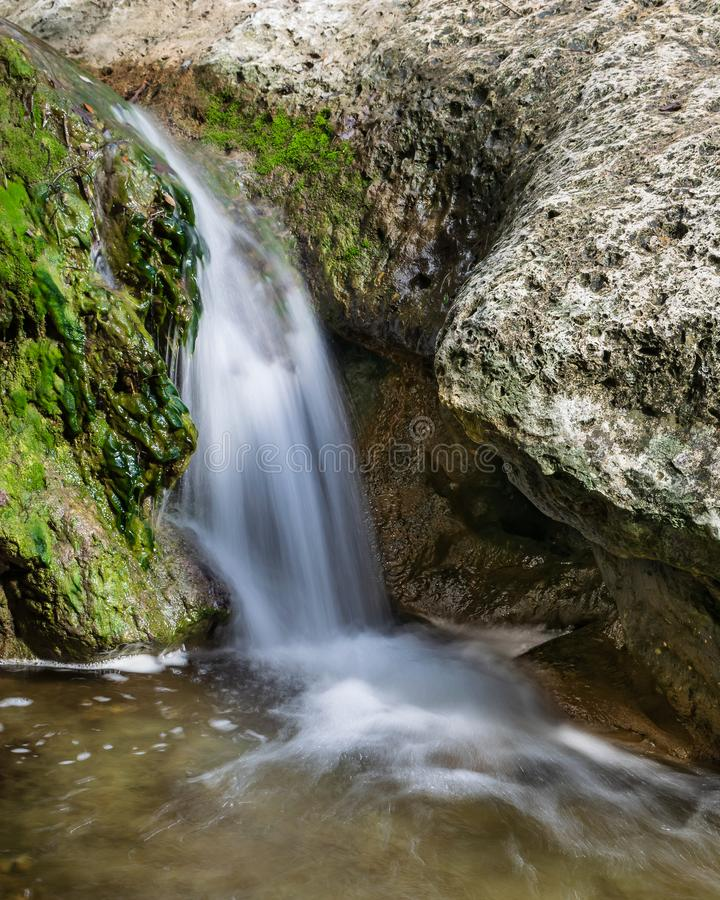 Waterfall Along Little Fern Hiking Trail at River Place, Austin royalty free stock photo