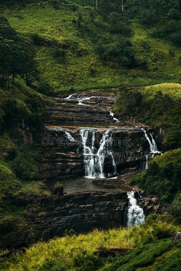 Free Waterfall Among The Green Mountains. Waterfalls Of Sri Lanka. Landscapes Of Asia. Aerial Photography. Tea Plantation. Green Hill. Royalty Free Stock Image - 157559636