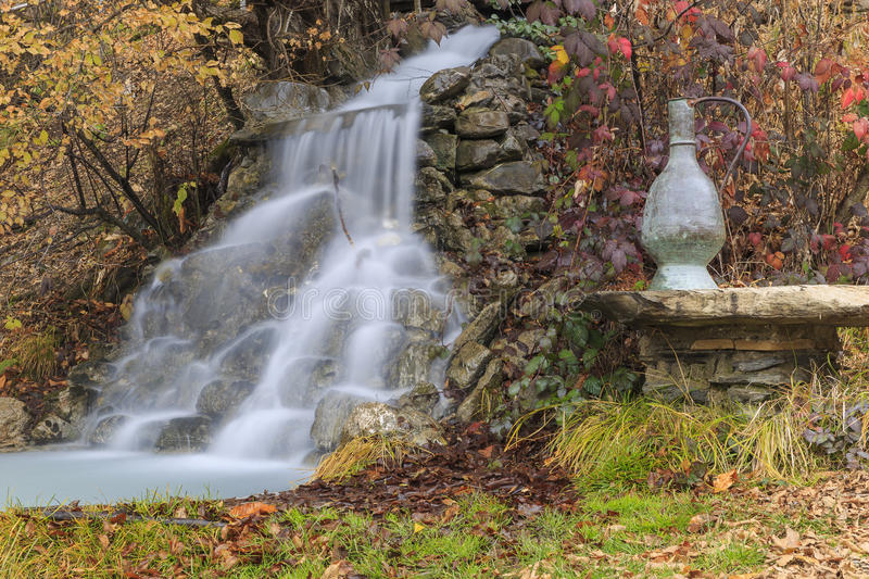 Waterfall and the ancient vessel for water transfer.Village Vandam.Gabala.Azerbaijan. Nature royalty free stock image