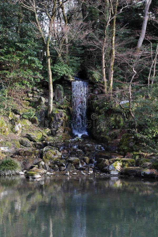 The waterfall around Kenrokuen, one of three most beautiful gardens in Japan. Taken in Kanazawa, February 2018 royalty free stock photos