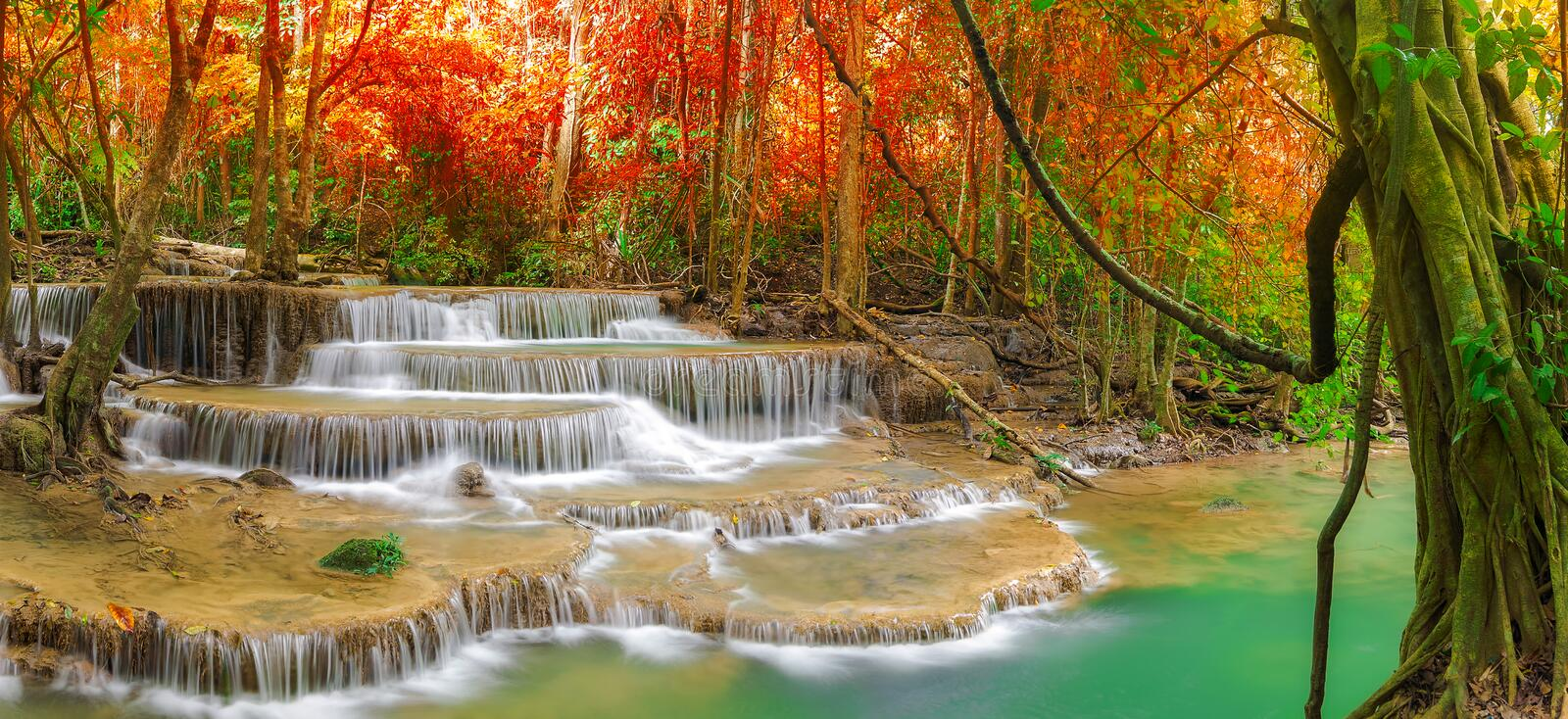 Waterfall in autumn forest. royalty free stock images