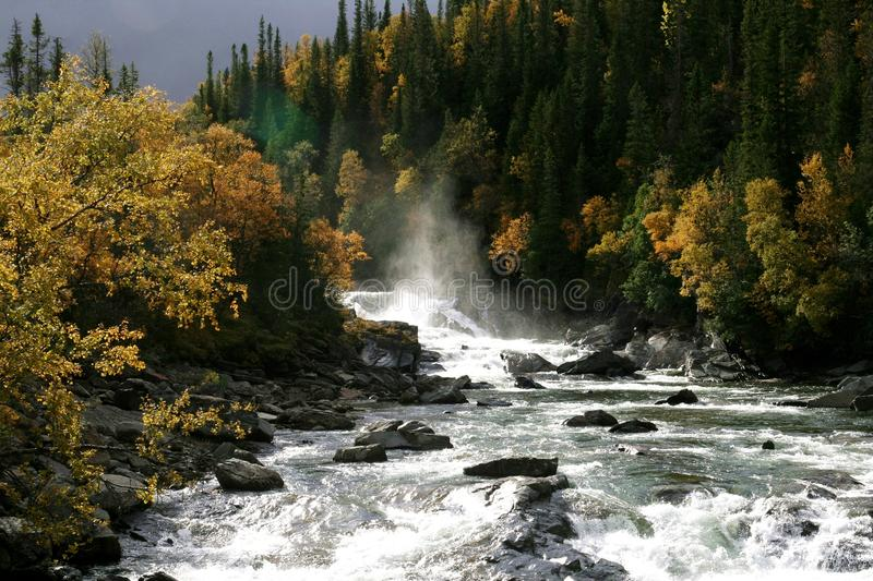 Waterfall in an autumn landscape stock photos