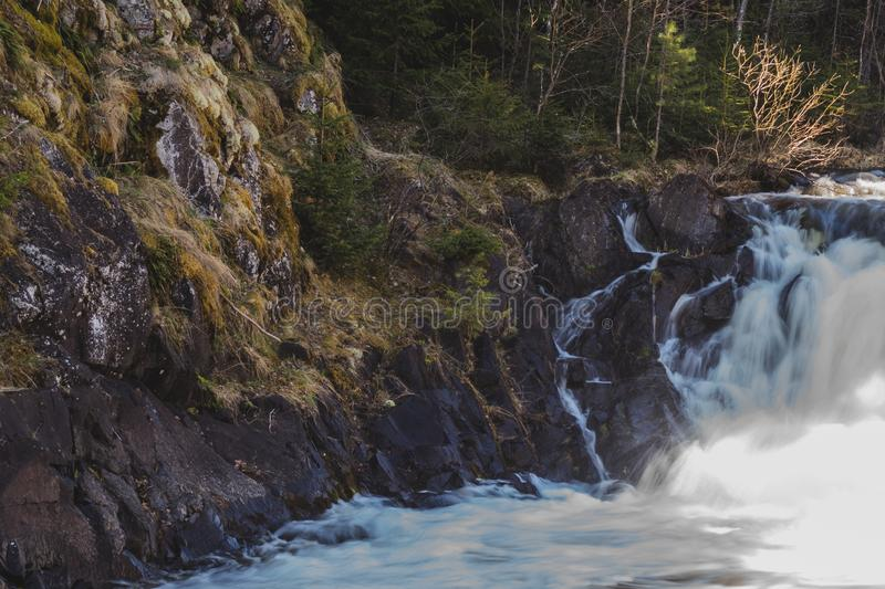 Waterfall background. rushing stream water. rocky flowing river stock photo