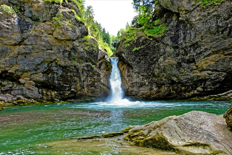 Waterfall basin in alpine geopark. The basin of the Buchenegger waterfalls - a scenic attraction in the nature park Nagelfluhkette in Allgäu, Germany royalty free stock photo