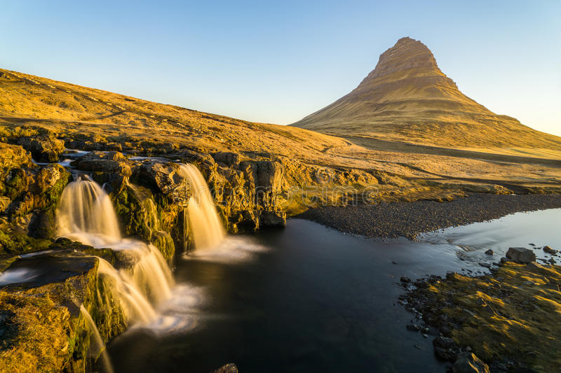 Waterfall with the big mountain in Iceland stock photos