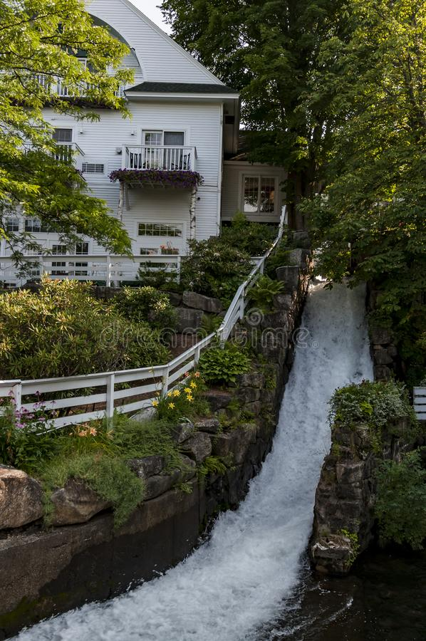 Waterfall in Camden, Maine USA. Waterfall near a house in downtown Camden, Maine, United States stock photography