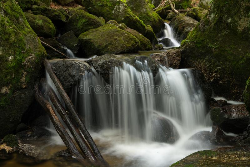 Waterfall, cascade between big rocks in ravine Ysperklamm royalty free stock photo