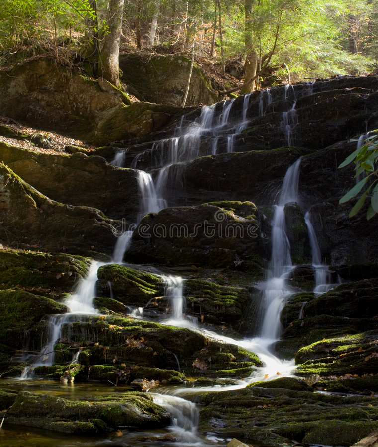 Waterfall cascade with moss royalty free stock photos