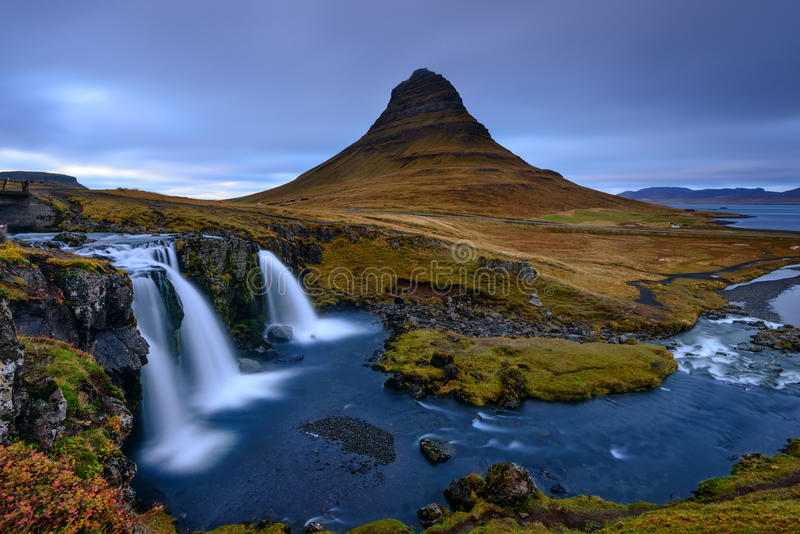 A waterfall cascade near Kirkjufell mountain in Iceland. stock photos