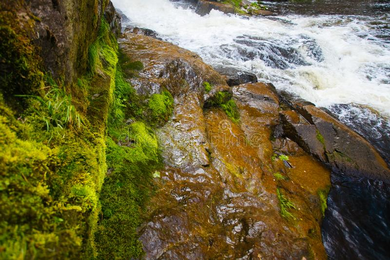 Waterfall cascade washing big stones close-up. Mountain landscape royalty free stock photography