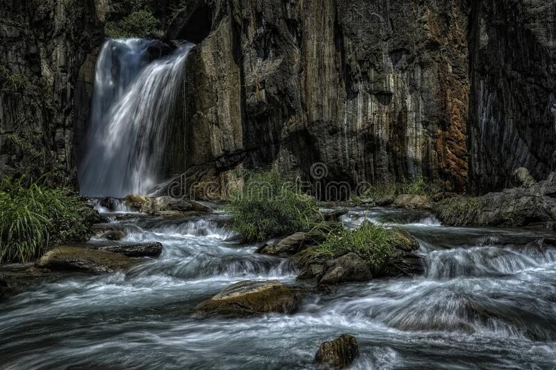 Waterfall and cascading creek stock photography