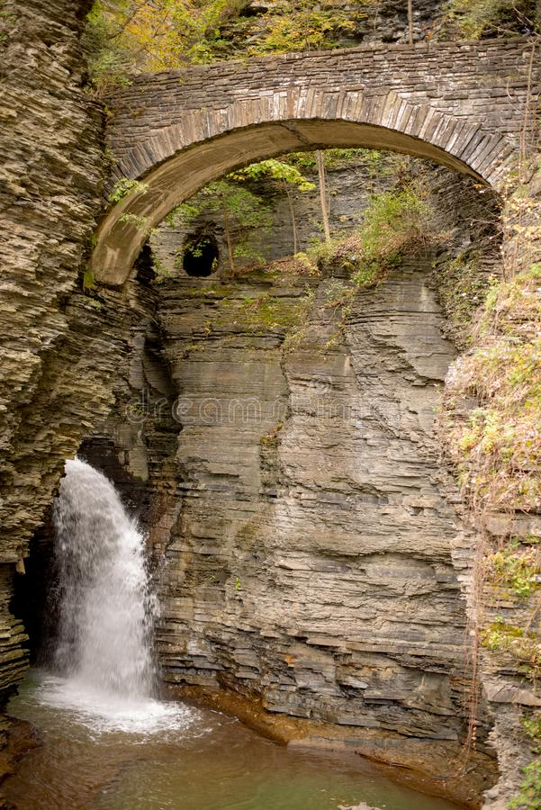 Waterfall cascading over Glen Gorge in Watkins Glen state park royalty free stock photography