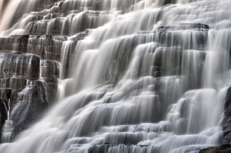 Waterfall cascading water closeup stock images
