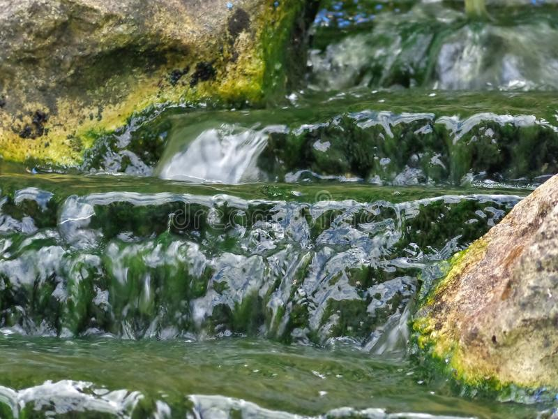 Waterfall Close-Up. A close-up of a small waterfall running into a pond in an English garden stock image