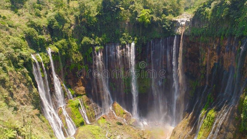 Waterfall Coban Sewu Java Indonesia. Beautiful waterfall Coban Sewu in tropical forest, Java Indonesia. aerial view tumpak sewu waterfall in rainforest royalty free stock photography